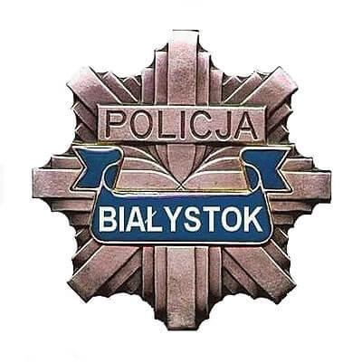 """Grafika przedstawia logo Białostockiej Policji. Jest to odznaka policyjna z napisem """"Białystok"""""""